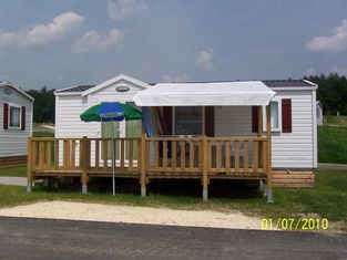China Prefab Mobile Homes Prefabricated House White Modular Small Vacation House supplier